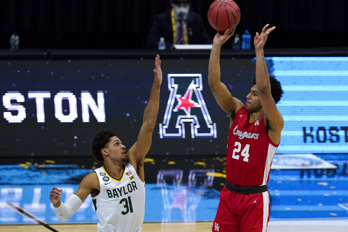 Houston guard Quentin Grimes (24) shoots over Baylor guard MaCio Teague (31) during the second half of a men's Final Four NCAA college basketball tournament semifinal game, Saturday, April 3, 2021, at Lucas Oil Stadium in Indianapolis. (AP Photo/Michael Conroy)