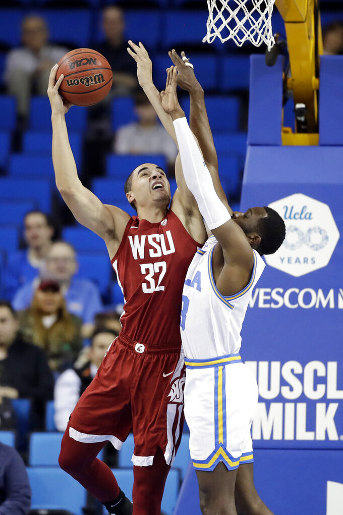 Washington State forward Tony Miller (32) shoots over UCLA guard Prince Ali during the first half of an NCAA college basketball game Thursday, Feb. 13, 2020, in Los Angeles. (AP Photo/Marcio Jose Sanchez)