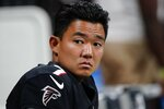 Atlanta Falcons kicker Younghoe Koo (7) sits on the bench during the second half of a preseason NFL football game against the Tennessee Titans, Friday, Aug. 13, 2021, in Atlanta. (AP Photo/John Bazemore)