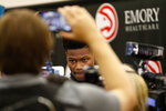 Atlanta Hawks first-round NBA draft pick Cam Reddish of Duke speaks to reporters during a news conference Monday, June 24, 2019, in Atlanta. (AP Photo/John Bazemore)