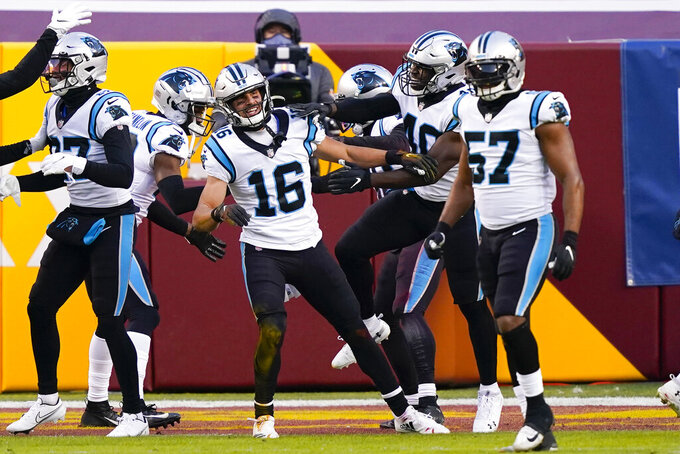 Carolina Panthers wide receiver Brandon Zylstra (16) is surround by teammates after scoring a touchdown during the first half of an NFL football game against the Washington Football Team, Sunday, Dec. 27, 2020, in Landover, Md. (AP Photo/Susan Walsh)