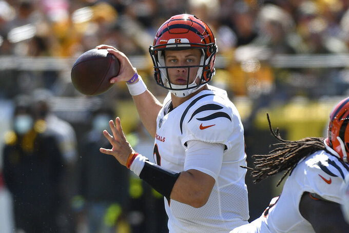 Cincinnati Bengals quarterback Joe Burrow (9) looks to pass against the Pittsburgh Steelers during the first half an NFL football game, Sunday, Sept. 26, 2021, in Pittsburgh. (AP Photo/Don Wright)