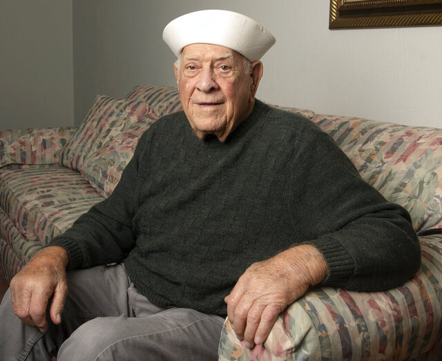 Michael Kemple, 93 poses for a portrait at his home Wednesday, Jan. 6, 2021, in Elizabeth, Pa.  Kemple served in the United States Merchant Marines from 1944 to 1945. During his tour, he served aboard a ship that transported supplies to the Russian port city of Murmansk. (Pittsburgh Post-Gazette via AP)