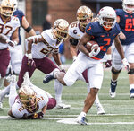 Illinois running back Reggie Corbin (2) breaks a tackle to score Illinois' first touchdown of the game against Minnesota in the first half of an NCAA  college football game, Saturday, Nov. 3, 2018, in Champaign, Ill. (AP Photo/Holly Hart)
