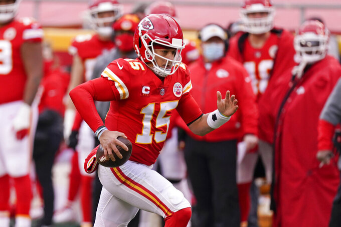 Kansas City Chiefs quarterback Patrick Mahomes scrambles during the first half of an NFL divisional round football game against the Cleveland Browns, Sunday, Jan. 17, 2021, in Kansas City. (AP Photo/Charlie Riedel)