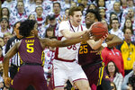 Wisconsin's Nate Reuvers, center, battles between Minnesota's Marcus Carr (5) and Daniel Oturu during the first half of an NCAA college basketball game Sunday, March 1, 2020, in Madison, Wis. (AP Photo/Andy Manis)