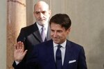 Italian Premier Giuseppe Conte waves at Rome's Quirinale Presidential Palace, Wednesday, Sept. 4, 2019. The Italian presidential palace says Premier Giuseppe Conte has formed a new government, a coalition of the populist 5-Star Movement and left-leaning Democrats that shuts out of power right-wing leader Matteo Salvini. (AP Photo/Gregorio Borgia)