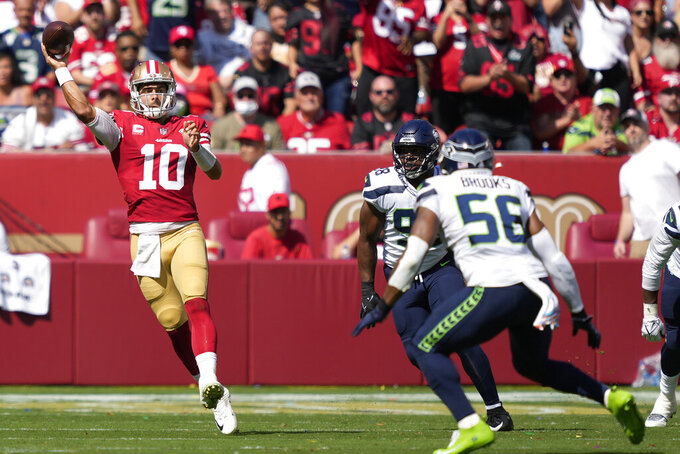 San Francisco 49ers quarterback Jimmy Garoppolo (10) passes against the Seattle Seahawks during the first half of an NFL football game in Santa Clara, Calif., Sunday, Oct. 3, 2021. (AP Photo/Tony Avelar)