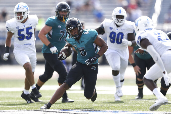 Coastal Carolina running back Shermari Jones (5) runs for a first down during the second half of a NCAA college football game against Buffalo in Buffalo, N.Y. on Saturday, Sept. 18, 2021. (AP Photo/Joshua Bessex)