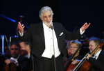 Opera star Placido Domingo salutes spectators at the end of a concert in Szeged, Hungary, Wednesday, Aug. 28, 2019. Domingo continued his calendar of European engagements unabated despite allegations of sexual harassment, appearing Wednesday at a concert in southern Hungary to inaugurate a sports complex for a local Catholic diocese.(AP Photo/Laszlo Balogh)