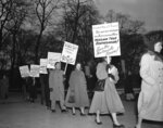 FILE - In this Jan. 30, 1951 file photo, as temperatures drop below freezing, demonstrators march in front of the White House in Washington, in what they said was an effort to persuade President Harry Truman to halt execution of seven Black men sentenced to death in Virginia on charges of raping a white woman. Virginia Gov. Ralph Northam granted posthumous pardons Tuesday, Aug. 31, 2021 to seven Black men who were executed in 1951 for the rape of a white woman, in a case that attracted pleas for mercy from around the world and in recent years has been denounced as an example of racial disparity in the use of the death penalty. (AP Photo/Henry Burroughs, File)