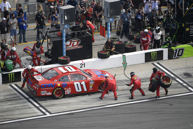 Stephen Leicht (01) makes a stop on pit road during a NASCAR Xfinity Series auto race at Daytona International Speedway Saturday, Feb. 16, 2019, in Daytona Beach, Fla. (AP Photo/Phelan M. Ebenhack)