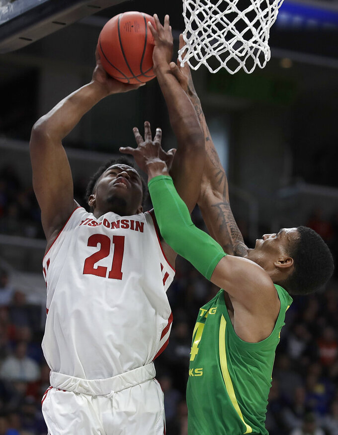 Wisconsin guard Khalil Iverson (21) shoots against Oregon forward Kenny Wooten during the first half of a first-round game in the NCAA men's college basketball tournament Friday, March 22, 2019, in San Jose, Calif. (AP Photo/Ben Margot)