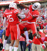 Houston wide receiver Raelon Singleton (15) celebrates his touchdown with Bryson Smith, right, and Marquez Stevenson during the second half of an NCAA college football game against South Florida, Saturday, Oct. 27, 2018, in Houston. (AP Photo/Eric Christian Smith)
