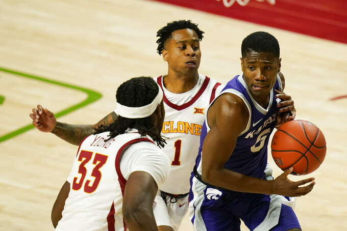 Kansas State guard Rudi Williams, right, drives past Iowa State forward Solomon Young (33) and guard Tyler Harris (1) during the first half of an NCAA college basketball game, Tuesday, Dec. 15, 2020, in Ames, Iowa. (AP Photo/Charlie Neibergall)