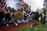 Minnesota head coach P.J. Fleck, right, leads his team onto the field to play Ohio State in an NCAA college football game Thursday, Sept. 2, 2021, in Minneapolis. (AP Photo/Bruce Kluckhohn)