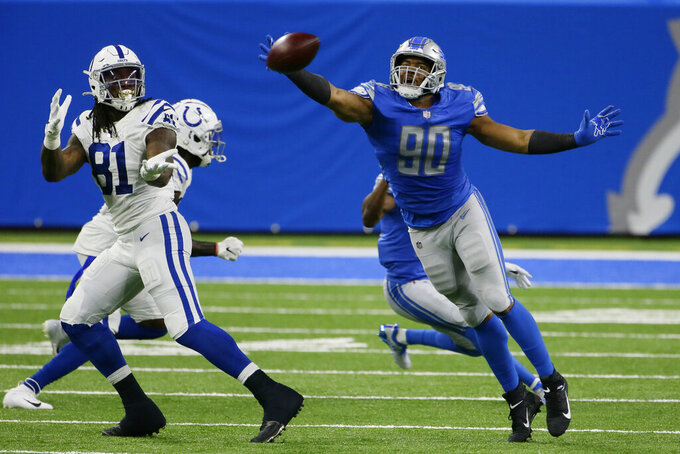 Detroit Lions defensive end Trey Flowers (90) deflects a pass intended for Indianapolis Colts tight end Mo Alie-Cox (81) during the first half of an NFL football game, Sunday, Nov. 1, 2020, in Detroit. (AP Photo/Duane Burleson)