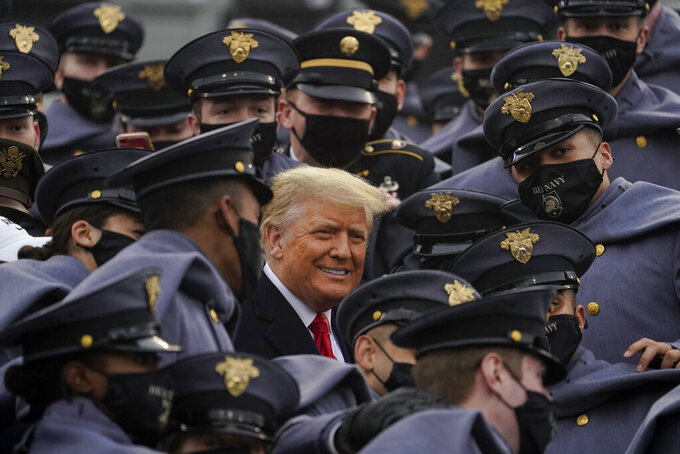 Surrounded by Army cadets, President Donald Trump watches the 121st Army-Navy Football Game in Michie Stadium at the United States Military Academy, Saturday, Dec. 12, 2020, in West Point, N.Y. (AP Photo/Andrew Harnik)