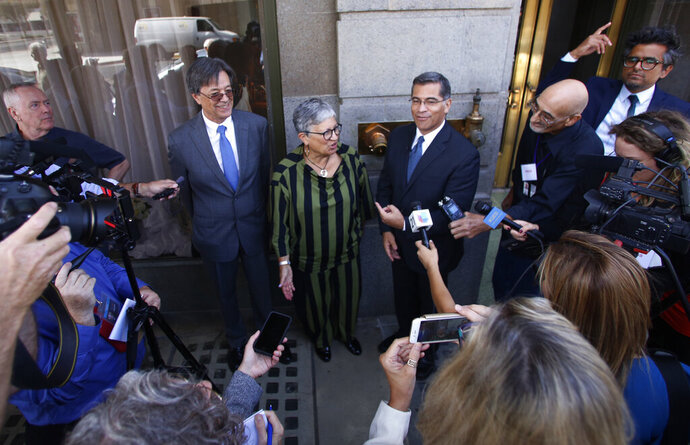 FILE - In this Sept. 24, 2018, file photo, from left, Cal/EPA Secretary Matthew Rodriguez, California Air Resources Board Chair Mary Nichols and California Attorney General Xavier Becerra talk to the media in Fresno, Calif. Nichols says she's not optimistic about striking a compromise with the Trump administration over its efforts to relax mileage standards, resolving a bitter standoff threatening to unleash years of court fights and confusion in the U.S. auto industry. (AP Photo/Gary Kazanjian, File)
