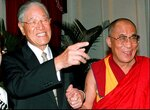FILE - In this March 27, 1997, file photo, Taiwan President Lee Teng-hui, left, holding hands with Tibetan spiritual leader the Dalai Lama, points to a source of interest at their first-ever meeting at a government guest house in Taipei. Local media are reporting that ex-Taiwanese President Lee Teng-hui, who oversaw the island's transition to full democracy, has died. Lee was 97 and had largely dropped out of public life in his later years. (AP Photo/Yeh Tao-chuan, Pool)