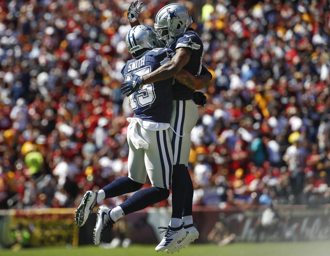 Dallas Cowboys wide receiver Devin Smith (15) celebrates his touchdown with teammate wide receiver Michael Gallup (13) in the first half of an NFL football game against the Washington Redskins, Sunday, Sept. 15, 2019, in Landover, Md. (AP Photo/Alex Brandon)
