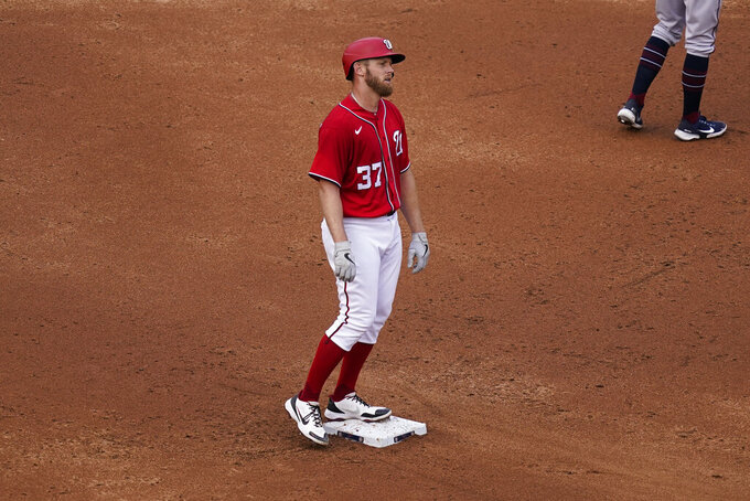 Washington Nationals' Stephen Strasburg reacts as he stands on second base after hitting a double during the third inning of the second baseball game of a doubleheader against the Atlanta Braves, at Nationals Park, Wednesday, April 7, 2021, in Washington. (AP Photo/Alex Brandon)