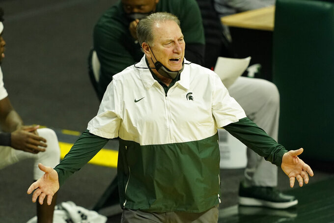 Michigan State head coach Tom Izzo watches from the sideline during the first half of an NCAA college basketball game against Michigan, Sunday, March 7, 2021, in East Lansing, Mich. (AP Photo/Carlos Osorio)