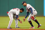 Minnesota Twins' Jorge Polanco, left, and Byron Buxton celebrate after defeating the Cleveland Indians 5-2 in a baseball game, Monday, Sept. 6, 2021, in Cleveland. (AP Photo/Tony Dejak)
