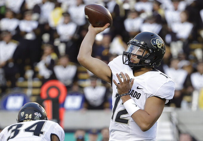 Colorado quarterback Steven Montez passes against California during the first half of an NCAA college football game in Berkeley, Calif., Saturday, Nov. 24, 2018. (AP Photo/Jeff Chiu)