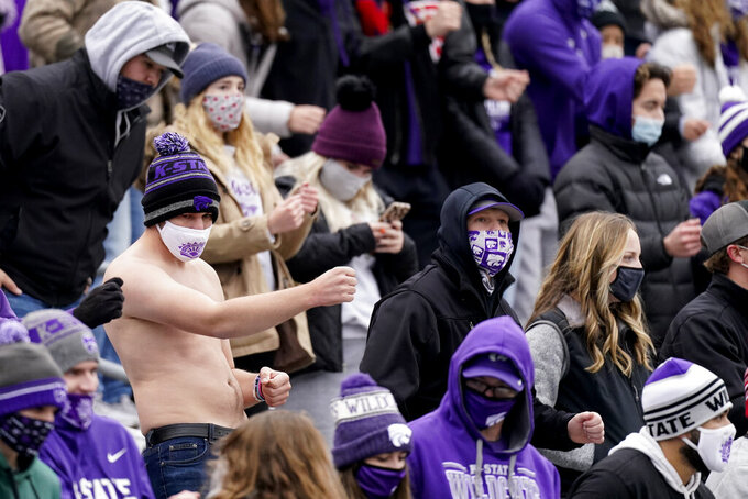 Kansas State fans celebrate during the first half of an NCAA football game against Kansas Saturday, Oct. 24, 2020, in Manhattan, Kan. (AP Photo/Charlie Riedel)