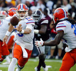 FILE - In this Sept. 29, 2018, file photo, Florida quarterback Feleipe Franks (13) pitches out to running back Jordan Scarlett (25) during the first half of an NCAA college football game against Mississippi State, in Starkville, Miss. Coming off consecutive road wins against Tennessee and Mississippi State, Florida (4-1, 2-1 SEC) returns home in hopes of topping last year's win total and notching its most significant victory since upsetting then-No. 3 Mississippi in 2015. (AP Photo/Rogelio V. Solis, File)