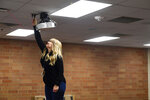 In this Wednesday, May 13, 2020 photo, Jamie Van Sloten, a social studies teacher at Washington High School in Sioux Falls, S.D., unplugs the last item in her classroom before leaving for summer. (Erin Bormett/The Argus Leader via AP)