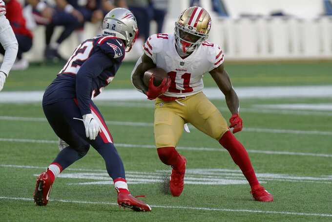 San Francisco 49ers wide receiver Brandon Aiyuk (11) runs after catching a pass as New England Patriots defensive back Devin McCourty (32) gives chase in the first half of an NFL football game, Sunday, Oct. 25, 2020, in Foxborough, Mass. (AP Photo/Steven Senne)