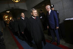 FILE - In this Jan. 20, 2017, file photo Supreme Court Chief Justice John Roberts, right, and Justice Anthony Kennedy arrive on the West Front of the U.S. Capitol in Washington, for Donald Trump's inauguration ceremony as the 45th president of the United States. (Win McNamee/Pool Photo via AP, File)