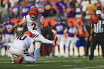 Cincinnati Bengals kicker Evan McPherson (2) hits a field goal to defeat the Minnesota Vikings during overtime of an NFL football game, Sunday, Sept. 12, 2021, in Cincinnati. The Bengals won 27-24. (AP Photo/Aaron Doster)