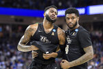 Central Florida guard Dayon Griffin, left, is comforted by Ceasar DeJesus (4) after a second-round game against Duke in the NCAA men's college basketball tournament Sunday, March 24, 2019, in Columbia, S.C. Duke won 77-76. (AP Photo/Sean Rayford)