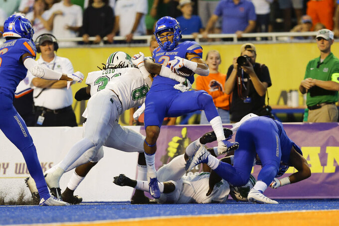 Boise State wide receiver Khalil Shakir, center, is stopped just short of the goal line after a long run during the first half of an NCAA college football game against Marshall in Boise, Idaho, Friday, Sept. 6, 2019. (AP Photo/Otto Kitsinger)