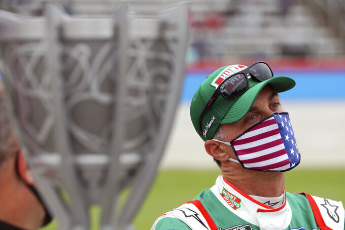 Kevin Harvick (4) waits on the grid before a NASCAR Cup Series auto race at Texas Motor Speedway in Fort Worth, Texas, Sunday, Oct. 25, 2020. (AP Photo/Richard W. Rodriguez)