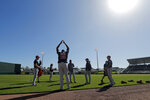 In this Feb. 14, 2019, photo, Minnesota Twins starting pitcher Michael Pineda (35) warms up as pitchers and catchers report for their first team workout at their spring training baseball facility in Ft. Myers, Fla. The Twins signed Michael Pineda more than a year before he'll be cleared to pitch, aiming for what could be a bargain for the rotation this season if the big right-hander bounces back from elbow surgery. (AP Photo/Gerald Herbert)