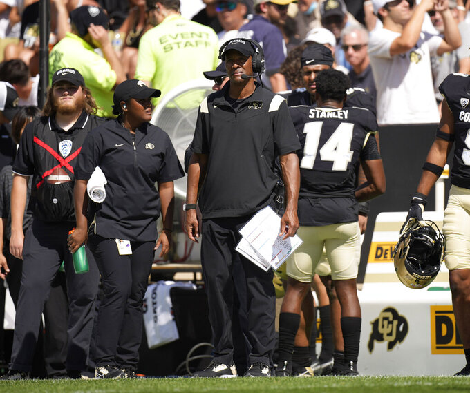 Colorado head coach Karl Dorrell, center, looks on in the second half of an NCAA college football game against Minnesota, Saturday, Sept. 18, 2021, in Boulder, Colo. Minnesota won 30-0. (AP Photo/David Zalubowski)