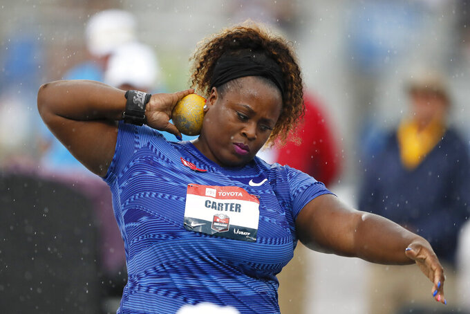 FILE - Michelle Carter sets to throw during the women's shot put at the U.S. Championships athletics meet in Des Moines, Iowa, in this Sunday, July 28, 2019, file photo. Reigning Olympic shot put champion Michelle Carter won't compete at the U.S. track and field trials after having a benign tumor removed from her right ankle. The 35-year-old will cheer on her friends and fellow competitors. (AP Photo/Charlie Neibergall, File)