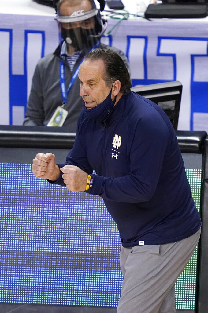 Notre Dame head coach Mike Brey directs his team during the second half of an NCAA college basketball game against North Carolina in the second round of the Atlantic Coast Conference tournament in Greensboro, N.C., Wednesday, March 10, 2021. (AP Photo/Gerry Broome)