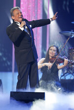 FLE - In this April 28, 2011 file photo, Jose Jose performs during the Latin Billboard Awards, in Coral Gables, Fla. Local media outlets report that the Mexican crooner died Saturday, Sept. 28, 2019 from pancreatic cancer. He was 71. (AP Photo/Carlo Allegri, File)
