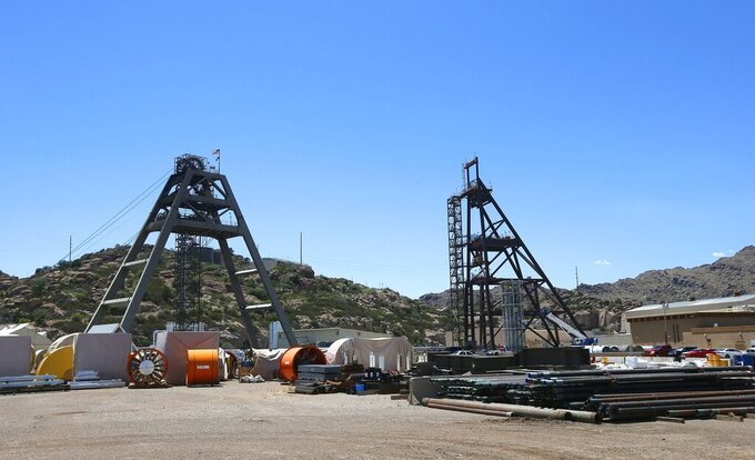 FILE - This file photo taken Monday, June 15, 2015, shows the Resolution Copper Mining area Shaft #9, right, and Shaft #10, left, that awaits the expansion go ahead in Superior, Ariz. The U.S. Forest Service released an environmental review Friday, Jan. 15, 2021, that paves the way for the creation of one of the largest copper mines in the United States, against the wishes of a group of Apaches who have been trying for years to stop the project. The mountainous land near Superior is known as Oak Flat or Chi'chil Bildagoteel. It's where Apaches have harvested medicinal plants, held coming-of-age ceremonies, and gathered acorns for generations. (AP Photo/Ross D. Franklin, File)