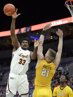 Loyola of Chicago's Franklin Agunanne (33) is fouled on his way to the basket by Valparaiso's Derrik Smits (21) during the first half of an NCAA college basketball game in the quarterfinal round of the Missouri Valley Conference tournament, Friday, March 8, 2019, in St. Louis. (AP Photo/Jeff Roberson)
