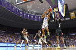 LSU guard Tremont Waters (3) puts the ball up while driving the lane as Vanderbilt forward Aaron Nesmith (24) and Vanderbilt guard Saben Lee (0) defend in the first half of an NCAA college basketball game, Saturday, March 9, 2019, in Baton Rouge, La. (AP Photo/Bill Feig)