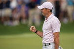 Rory McIlroy reacts after winning on the 18th hole during the fourth round of the Wells Fargo Championship golf tournament at Quail Hollow on Sunday, May 9, 2021, in Charlotte, N.C. (AP Photo/Jacob Kupferman)