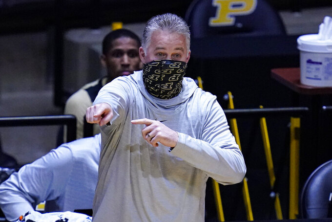 Purdue head coach Matt Painter gestures during the first half of an NCAA college basketball game against Maryland in West Lafayette, Ind., Friday, Dec. 25, 2020. (AP Photo/Michael Conroy)
