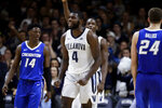Villanova's Eric Paschall (4) celebrates between Creighton's Kaleb Alejandro Joseph (14) and Mitch Ballock (24) during overtime of an NCAA college basketball game Wednesday, Feb. 6, 2019, in Villanova, Pa. Villanova won 66-59. (AP Photo/Matt Slocum)