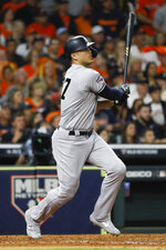 New York Yankees' Giancarlo Stanton watches his home run against the Houston Astros during the sixth inning in Game 1 of baseball's American League Championship Series Saturday, Oct. 12, 2019, in Houston. (AP Photo/Matt Slocum)